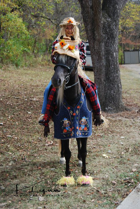 Child and horse in scarecrow costume